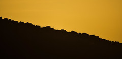 Living On The Edge (Deepgreen2009) Tags: tenerife sunset silhouette hill slope outline buildings houses climb pylons golden twotone diagonal