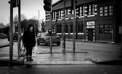 wait (Chilanga Cement) Tags: bw blackandwhite monochrome lady woman stormdennis ormskirk crossing shopping daylight day sunday bag bags pavement sidewalk traffic