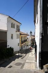 Cuesta del Realejo, Granada (mattk1979) Tags: andalucia granada spain europe city buildings central town sun outdoors sky clouds street steep hill narrow old