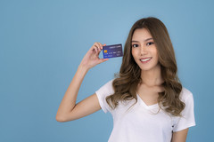 Portrait of a lovely asian young girl in white T Shirt showing credit card (I love landscape) Tags: sale hand card credit money paying smiling business finance hold bank discount holding banking teenager lady woman purchase shopping japanese korean asian asia thai showing adult looking charming person background portrait girl attractive female copy payment casual beautiful smile space advertising isolated happy caucasian young customer standing buyer people pay