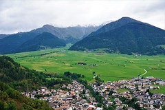 View over Mals in South Tyrol near the border to Austria and Switzerland (pisces2386) Tags: green valley europe italy meadow mountain alpine tyrol vinschgau mals south alp bolzano pass reschen landscape nature outdoor view grass snow scenery austria alps beautiful clouds land country natural mist idyllic environment field hill scene rural beauty panorama sky ortler mountains glurns alto adige venosta glorenza switzerland burgeis