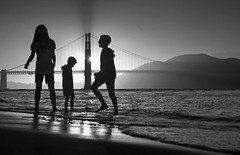 Playtime near the Golden Gate (PeterThoeny) Tags: sanfrancisco california goldengate goldengatebridge bridge crissyfield park people kids children play bay water sea sky ocean outdoor sun sunset day clear gold goldenhour reflection waterreflection beach mountain monochrome blackandwhite sony a6000 sel55210 1xp raw photomatix hdr qualityhdr qualityhdrphotography fav200