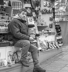 Business is slow. (Tony Smith Photo's) Tags: bw isolated man white advertising awning background blackandwhite booth business buyer characters city commerce commercial counter customer display exhibition fair kiosk market marketing marketplace markets monochrome norwich outdoor outside people person presentation retail sale sell seller selling shop shopping showcase souvenirs stall stand store street streetphotography tent trade trader trading traditional urban vendor england unitedkingdom
