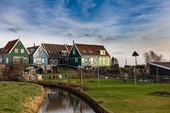 Wooden houses in Marken's countryside (NL) (Luca Livio) Tags: canal nature grass green countryside rustic houses woodenhouses europe waterland holland netherlands marken