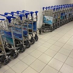 airport (badtweetgirl) Tags: blue colour netherlands lines amsterdam metal airport pattern interior space empty minimal chrome inside shape schipol carts minimalist trolleys sign signage