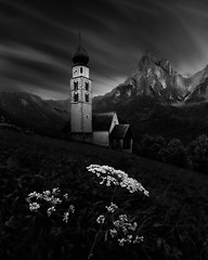 Faithful (One_Penny) Tags: dolomiten italien italy alps dolomites landscape mountains mountainscape nature southtyrol religion faith flowers church building architecture peak santner santnerspitze schlern seis dark contrast black blackandwhite clouds cloudscape sky light fineart longexposure longshutterspeed ndfilter moody dramatic