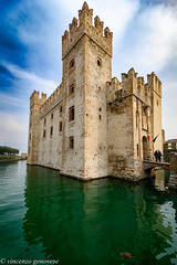 Sirmione italy (vincenzo genovese) Tags: church popular san people castello facade monument turquoise entrance heritage history urban peninsula green roccascaligera verona sunrise sirmionecastle aerialview coastline coast sirmione water sky italy lake europe castle travel old garda tourism summer medieval town view landscape lombardy italian architecture landmark vacation city building blue fort ancient famous italia aerial nature lago historic scaliger boat harbor port panorama beautiful gardalake tower destination lombardia fortress wall vincenzogenovese