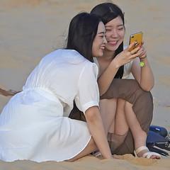 Korean girls sharing photos on iPhone (zeeimage) Tags: ấpnhơnhòa tỉnhbìnhthuận vietnam korean girls sharing photos iphone koreangirls olympus em1x mzuiko digital ed 40150mm f28 pro olympusem1x olympus40150mmf28 apple appleiphone travel holiday holidaying