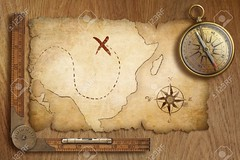 aged treasure map, ruler and old gold compass on wooden table top view (batuhanzze) Tags: adventure aged antique arrow background brass bronze compass cross directional discovery exploration finding geography gold golden grunge illustration isolated location manuscript map metal nautical navigation north old paper path realistic retro ring ruler solid symbol table topview tour travel treasure vintage wooden world