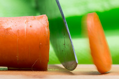 Macro Mondays - Vegetables (Geolilli) Tags: macro mondays vegetables vegetarian macromondays knife chef vitamins canon 100mm28 100mm motion color carrot cutting board