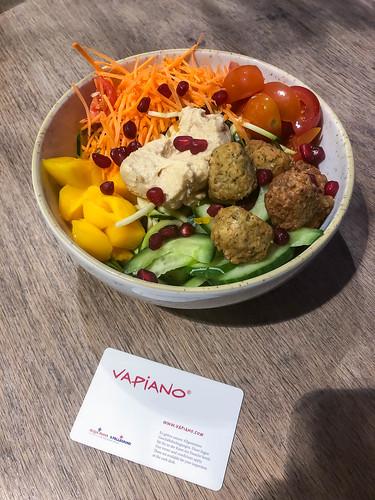 Vegan bowl at Vapiano with roman salad, falafel, hummus, mango, carrots, cherry tomatoes, cucumber and pomegranate seeds