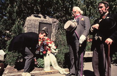 Reichenbach - Dr Watson (Tim Owen) lays his wreath at the memorial plaque, but keeps an eye on Count Sylvius (Frank Allen) and Inspector Lestrade (Roger Johnson) (photo courtesy of Tim Owen)