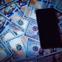 On the background of dollars black phone. Dark light vignette. (JoTo PR) Tags: background dollar phone hundred one blue roll bank banking board business cash closeup concept currency economy exchange finance money payment success abstract design market bill buy cover credit debit denim coins paper savings industrial federalreserve banknote light lab income green experimental stacked graphic bitcoin investment circuit financial pay symbol engineering russianfederation