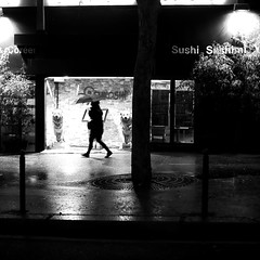 Through the night (pascalcolin1) Tags: paris13 femme woman nuit night lumière light reflets reflection chiens dogs pluie rain parapluie umbrella photoderue streetview urbanarte noiretblanc blackandwhite photopascalcolin 50mm canon50mm canon