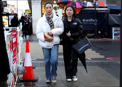 `2874 (roll the dice) Tags: london westminster marylebone w1 bakerstreet streetphotography pretty sexy girls canon tourism tourists urban unaware unknown england uk classic art portrait strangers candid sad mad fun funny surreal couple love reaction eyes weather natural wisdom korean asian chinese mask sandfords northface bollards wet colour holiday shock roadworks