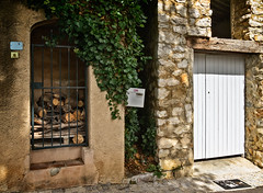 Firewood under lock and key (Tigra K) Tags: france 2019 bouchesdurhône vauvenargues door metal medieval portal lattice architdetail wood rock village ruin vine