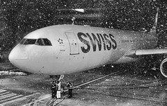 Snowy Swiss [explored] (risingthermals) Tags: winter storm snow blizzard falling snowflakes windy blustery cold kord il illinois usa united states america north midwest aviation commercial civil airline aeroplane airplane aircraft jetliner jet freezing gate swiss wing engine international people ground crew workers intercom talking