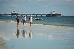 Beach walkers (radargeek) Tags: florida fl 2018 october fortmyers fortmyersbeach beach pier reflection skidoo indiana tshirt