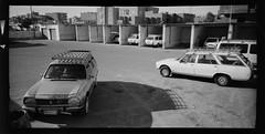 ras gharib peugeot taxi rank (Matt Jones (Krasang)) Tags: lomolca120 half frame hp5 egypt standdevelopment rodinal