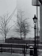 St Catherine's Wharf with a misty Tower Bridge (Tim Ravenscroft) Tags: lamp architecture towerbridge stcatherineswharf london mist fog monochrome blackandwhite blackwhite