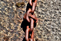 Rusty chain (Tony Worrall) Tags: north update place location uk visit area attraction open stream tour photohour photooftheday pics country item greatbritain britain british gb capture buy stock sell sale outside dailyphoto outdoors caught photo shoot shot picture captured ilobsterit instragram rusty chain crusty red metal decay links docks old past chained stockphotography stone nikon d3200