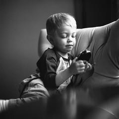 Playing with a Light Meter (Chase Hoffman) Tags: film mediumformat 6x6 chasehoffman chasehoffmanphotography hasselblad planar 120film hasselbladc80mmf28tzeissplanar 80mmf28 zeiss denver hasselblad500 ilford ilfordhp5 hp5 blackwhite bw monochrome blackandwhitefilm blackandwhite son boy portrait