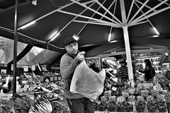 No time for this stuff (fotoflo86) Tags: catania sicilia sicily sizilien italien italy italia candid black white bw bianco nero bianconero monochrome street scene via strada passante passerby people fruit veg vendor stall vegetable stand shop ortofrutta negozio banco bancarella bag shopper hurry