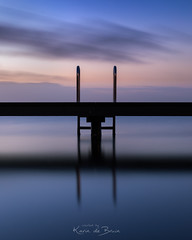 Calm before the storm! (karindebruin (OFF FOR A WHILE)) Tags: ouddorp zonsopkomst blauw steiger water symmetrie