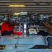 Sailors perform maintenance on an MH-60S Sea Hawk