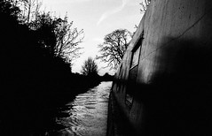 not dark yet (Mano Green) Tags: boat canal water waterway narrowboat shadow light ripple sky tree cheshire england uk spring april 2017 canon eos 300 40mm lens ilford hp5 35mm film pushed 800 ilfosol s epson perfection v550 black white high contrast monochrome