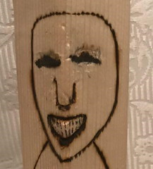 Jeffrey J. (Moxazza) Tags: woodcarving wood woodart handmade art woodwork carving woodcraft handcrafted wooden woodcarvings handcarved wooddesign woodsculpture carvingwood whittling woodworker sculpture carpentry woodcarver decor woodshop reclaimedwood woodcarvingart crack addict bad teeth evil wicked laughing maliciously crooked foul wretched dirty trickster joker eyes grinning portrait horrible scary ill mannered hooked addicted cheshire grin malicious tick