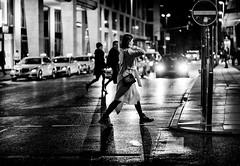 (graveur8x) Tags: woman candid street blackandwhite crossing night frankfurt germany deutschland streetphotography monochrome shadows shadow contrast lights cars silhouette walking people outdoor outdoors rain regen europe dark wet sidewalk black winter sony sonya7iii sonyfe85mmf18 sonyilce7m3 85mm signs