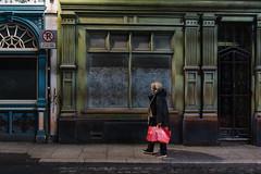 From The Sale (Stefan Waldeck) Tags: walls windows door grafitti woman shoppingbag street pavement night dublin ireland 2019 netzki stefanwaldeck stefan waldeck