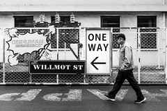 One way (Go-tea 郭天) Tags: qingdao shandong sign signage signboard one way fence happy arrow man walk walking alone lonely direction old cap movement left follow following street urban city outside outdoor people candid bw bnw black white blackwhite blackandwhite monochrome naturallight natural light asia asian china chinese canon eos 100d 24mm prime