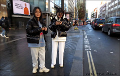 `2875 (roll the dice) Tags: london camden w1 streetphotography pretty sexy girls asian chinese couple mad sad fun funny surreal people reaction fashion traffic glasses uk classic art england urban unaware unknown portrait strangers candid mask canon tourism tourists eyes weather natural wisdom shock colour taxi trees bush mobile phone bollards roadworks puffer cold