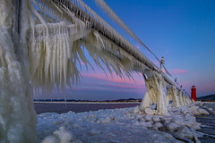 Looking back at Grand Haven (Notkalvin) Tags: grandhaven ice michigan notkalvin mikekline outdoors nopeople frozen winter icicles iced cold beauty nature puremichigan sunset