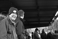 Football Fans (Bury Gardener) Tags: folks football footballfans isthmianfootballleague nonleague suffolk streetphotography street streetcandids snaps strangers candid candids people peoplewatching england eastanglia europe uk britain 2019 nikond7200 nikon bw blackandwhite monochrome mono