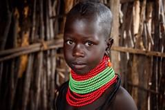 Turkana Girl (Rod Waddington) Tags: africa african afrique afrika uganda ugandan turkana tribe traditional tribal culture cultural child girl beads hut portrait indoor eastern
