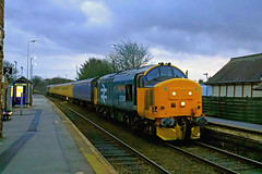 In low station lighting and dusk falling 37424 with 37409 at rear stop at St. Bees station for the single line token to Whitehaven on 18.2.20 with 1Q47 1055 Derby R.T.C.(Network Rail) to Carlisle test train (Paul Biggs) Tags: stbees 37424 cumbria cumbrian 1q47 37409 coast