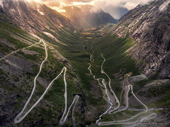 Trollstigen (Norway) (Andrea Moscato) Tags: andreamoscato norvegia norge bokmål nynorsk north europe view vivid vista day light luce shadow ombre white red yellow water art artist nature natura natural naturale landscape trail history historic panorama tourist attraction rock stones dji mavic air quadcopter drone overlook green street road grass bridge ponte deep car strada freshwater bend silhouette trees sky sunset dusk cielo clouds nuvole orange evening mountain montagna paesaggio