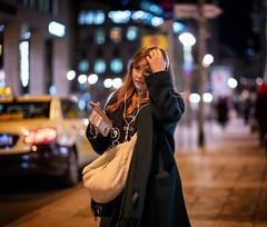 (graveur8x) Tags: woman candid street potrait frankfurt germany deutschland night wind motion hair lights city urban female girl dof bokeh dark bag blond stadt streetphotography strase taxi cab mobilephone outside outdoors winter sony sonya7iii sonyilce7m3 sonyfe85mmf18 85mm