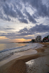 Cloudy afternoon (Vest der ute) Tags: spain beach sand buildings clouds sunset waves sea city fav25