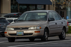 1996 Toyota Corolla (mlokren) Tags: 2020 car spotting photo photography photos pic picture pics pictures pacific northwest pnw pacnw oregon usa vehicle vehicles vehicular automobile automobiles automotive transportation outdoor outdoors 1996 toyota corolla beige sedan gold
