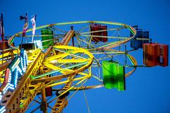 McDonagh Sky Wheel (ezeiza) Tags: minnesota mn stpaul saintpaul st saint paul minnesotastatefair statefair state fair carnival midway amusement amusementrides skywheel wheel ferriswheel doubleferriswheel allanherschell chancemanufacturing chancemfg chancerides mcdonaghsamusements mcdonagh amusements skyattractions sky attractions people chance rides mfg manufacturing light seat flag banner
