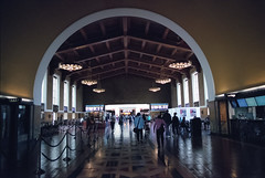 Los Angeles Union Station (Past Our Means) Tags: kodak kodakportra portra portra400 400 film filmphotography filmisnotdead analog analogue iconla canon ae1 canonae1 los ca angeles california train station union reflection shadow shadows people travel 35mm 28mm historical
