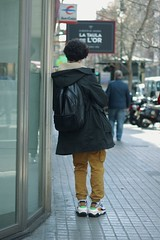 Waiting for... (ginevrarodelli1) Tags: man boy standing street road jacket cold sun sunny summer valencia spain portrait canon 550d 50mm focus balenciaga shows shoes clothes fashion bag backpack black