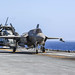 An F-35B Lightning II and a CH-53E Super Stallion are secured to USS America (LHA 6)