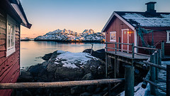 Sunset in Svolvaer - Norway - Travel photography (Giuseppe Milo (www.pixael.com)) Tags: svolvær nordland norway europe fisherman geotagged house landscape mountain net orange photo photography railing red rocks sea seascape sky sunset travel typical onsale