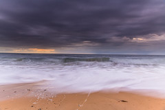 Sunrise Seascape and Rain Clouds (Merrillie) Tags: daybreak moody sunrise dawn rainclouds nature water sea landscape overcast sky waves newsouthwales rocks earlymorning morning seascape coast ocean australia nsw stormy coastal macmastersbeach outdoors waterscape clouds centralcoast cloudy macmasters
