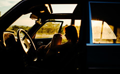 A sunset drive with a young woman in the car